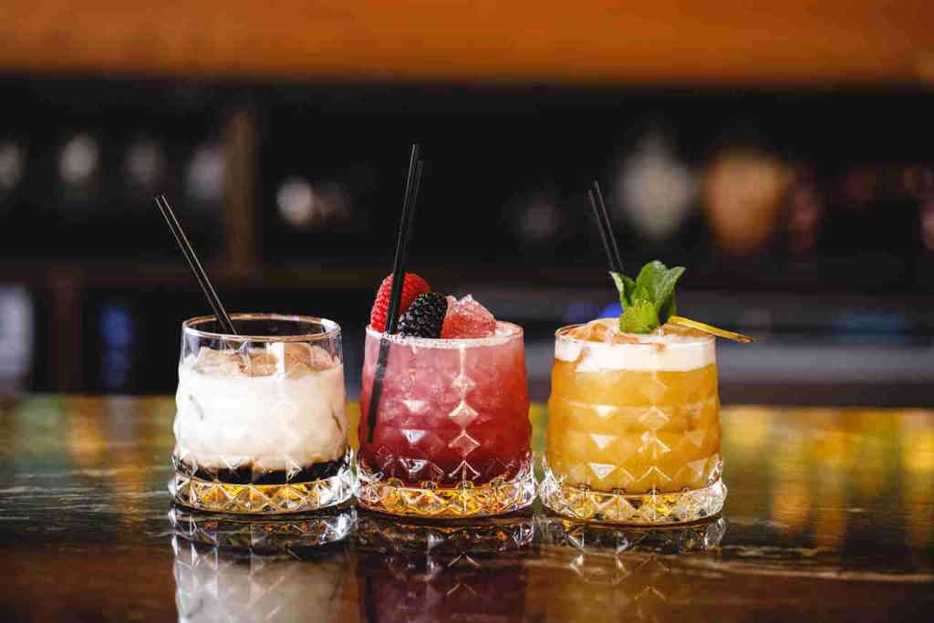 This image shows cocktails from Siamais Brindley Place, Birmingham, served on a bar.